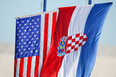 Croatian and American flags waving on white background — Stock Photo