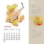 Müzik tasarım öğeleri ile 2014 için renkli sevimli takvim — Stok Vektör