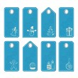 Set of blue tags with white christmas motifs — Stock Vector
