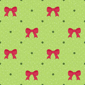 Green seamless pattern with red bows. Christmas background — Stockvector