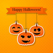 Halloween background with smiling pumpkins — Stock Vector