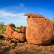 Granite eroded red rock formation, Devils Marbles, Australia — Stock Photo #12380700