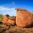 Granite eroded red rock formation, Devils Marbles, Australia - Stock Photo