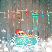 Christmas card with socks and cats — Stock Photo