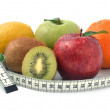 Group of fruits and measuring tape-concept — Stock Photo