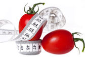 Measuring tape - healthy food and diet — Stock Photo