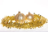 Gold tinsel and baubles — Stock Photo