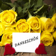 "Flower and a card ""Dankeschoen"" — Stock Photo"