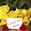 "Stock Photo: Flower and a card ""I love you Mom"""