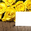 Bouquet of yellow with a card — Stock Photo