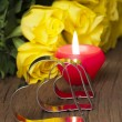 Yellow roses and candle — Stock Photo