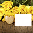 Stock Photo: Grettings with a bouquet of yellow roses