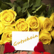 "Flower and a card ""Gutschein"" — Stock Photo"