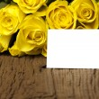 Yellow roses with writable card — Stock Photo #18732879