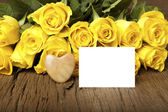Grettings with a bouquet of yellow roses — Stock Photo