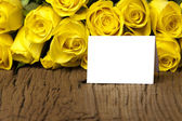 Yellow roses with a writable card — Stock Photo