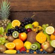 Fresh fruit in front of wooden wall — Stock Photo #19684595