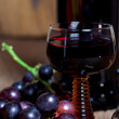 Glass of red wine and bottle - Stock Photo
