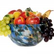 Colorful glass bowl with fruits — Stock Photo