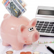 Stock prices with piggy bank and money — Stock Photo