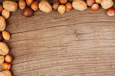 Wood background with nuts — Stock Photo