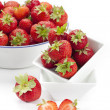Freshly harvested strawberries in enamel bowl — Stock Photo