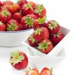 Stock Photo: Freshly harvested strawberries in enamel bowl