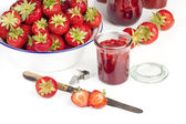 Strawberries and jam jars — Stock Photo