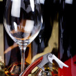 Stock Photo: Wine glass, wine bottle and corkscrew