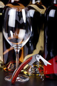 Wine glass, wine bottle and corkscrew — Stock Photo