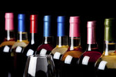 Some wine bottles and a wineglass — Stock Photo
