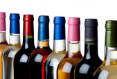 Different wine bottles in a row — Stock Photo
