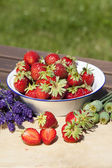 Strawberries, lavender and poppies in summer — Stock Photo
