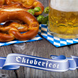 Stock Photo: Glass of beer, pretzels and Oktoberfest Banners