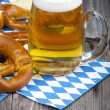 Glass of cold beer and pretzels — Stock Photo