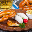 Veal sausage, Pretzels and Beer — Stock Photo