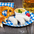 Veal sausage and pretzel on a paper plate — Stock Photo #32505653