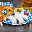 Veal sausage and pretzel on a paper plate — Stock Photo