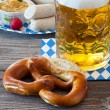 A large glass of beer and a pretzel — Stock Photo