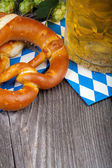 Glass of beer and pretzels — Stock Photo