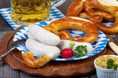 Typical Bavarian veal sausage snack on paper plate — Stock Photo