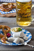 Veal sausage and pretzels — Stock Photo
