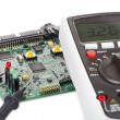 Digital multimeter and a circuit board — Stock Photo #32844993
