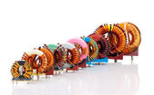 Selection of ten various Industrial Toroidal Choke Coils — Stock Photo