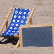 Sun Chair and Slate with Copy Space on the Beach — Stock Photo #33721063