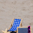 Beach scene with Sun Chair and Blackboard — Stock Photo