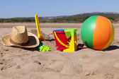 Beach scene with Toys and Straw Hat — Stock Photo