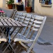 Chairs and tables in sidewalk cafe — Stock Photo