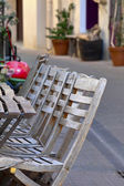 Chairs and tables in sidewalk cafe — Foto Stock
