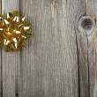 Christmas Card with golden Ribbon Bow — Stock Photo